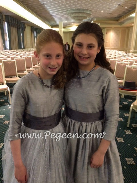 Flower girl dresses in silver and medium gray Left Style 372 and Right Style 345 from the Pegeen Classics Collection