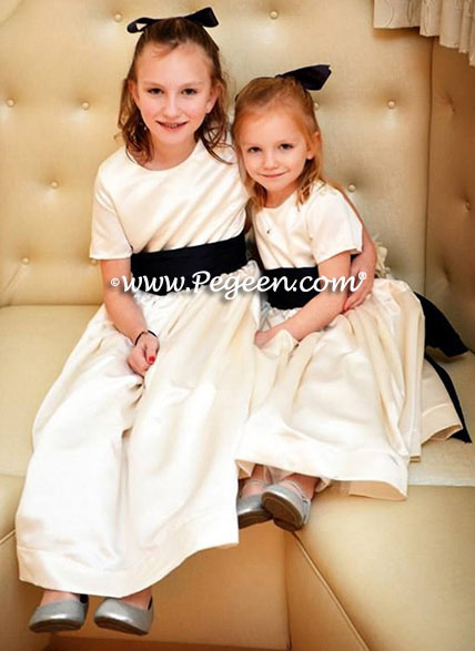 Flower girl dresses style 383 in imported ivory satin with navy silk bustles