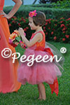 Flower Girl Dresses in of the Month for June 2015 in shades of orange and coral tulle