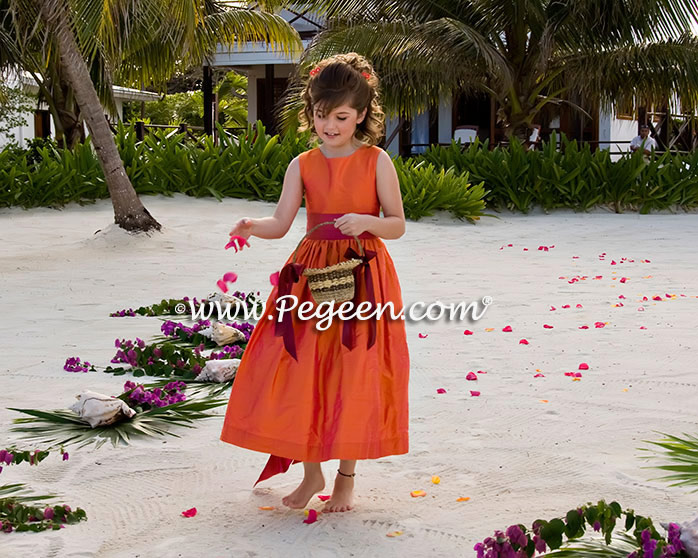 Flower girl dresses in Mango Orange and Raspberry Pink