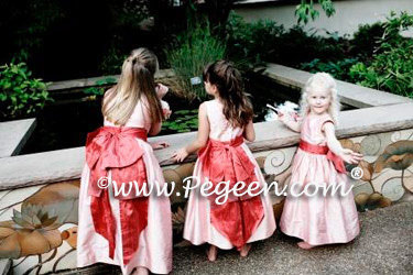 Pink and coral silk flower girl dresses by Pegeen