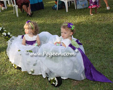 Pegeen Infant Flower Girl Dresses above in key lime and purple heart with flowers in back Style 802