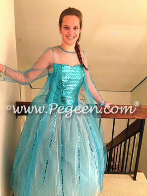 219678404a3 Turquoise Silk Flower Girl Dress with a Sequin Bodice and Cape
