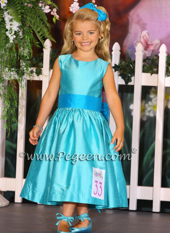 Style 345 pageant dress in Tiffany blue and turquoise with Cinderella Bow