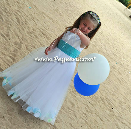 Custom flower girl girl dress in white tulle and trellis silk with bahama breeze sash and shells in the skirt