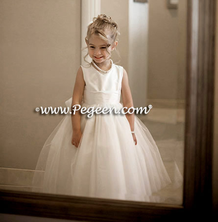 Custom flower girl dresses with layers and layers of tulle and beautiful flowers made from real silk