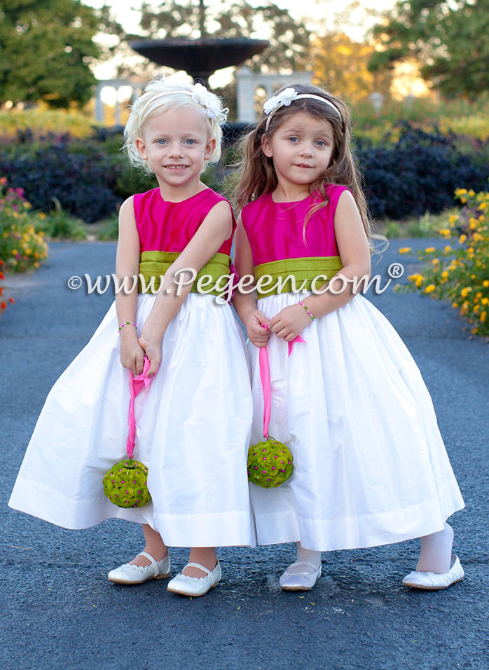 Hot pink, grass green and white flower girl dresses with a fabulous flower ball makes this smashingly beautiful