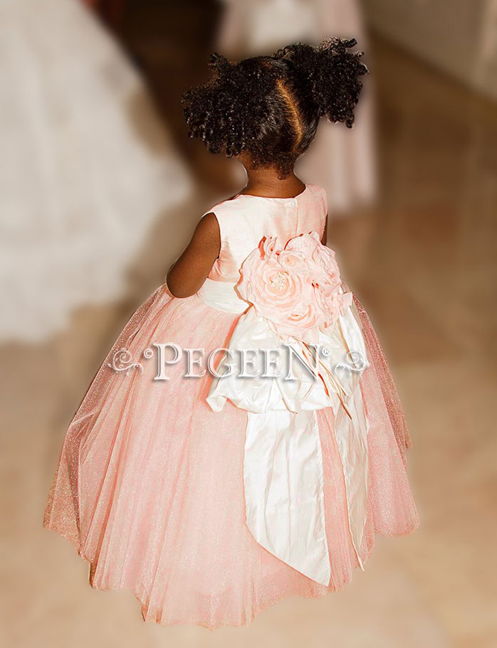 This bride chose various shades of ballet pink and ivory tulle flower girl dresses