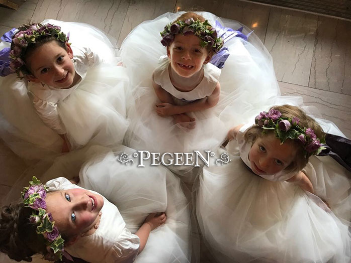 This bride chose various shades of lavender to accent her flower girls' white silk tulle dresses