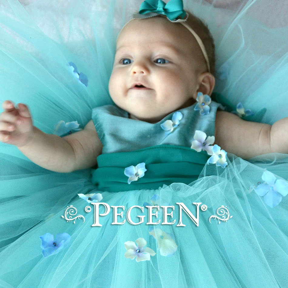 Aqua tulle with flower trim. Pegeen Babies for the little ones