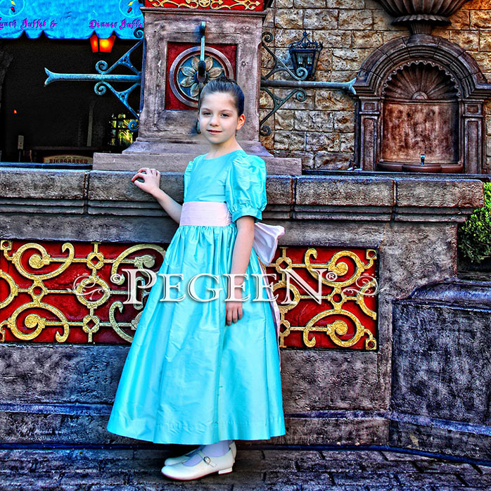 Our customer chose this Tiffany Blue and Peony Pink silk flower girl dress for her photo shoot at Disney World.